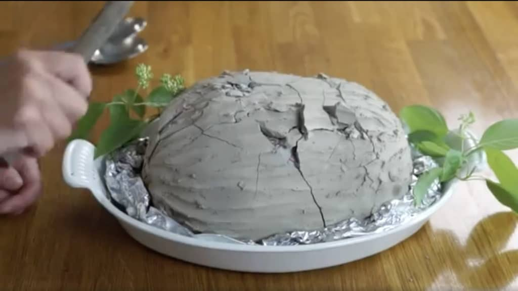 Cracked clay wrapped chicken.